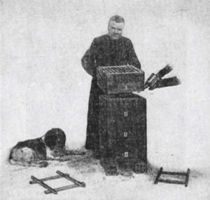 Abbe Emile Warre tends his modified tree trunk (The Warre Hive)