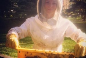 "A Step-By-Step Guide To Beekeeping In Edmonton If you're thinking about keeping honeybees in Edmonton you've probably come across the City of Edmonton's Urban Beekeeping page. If so, you've read about 4 steps, city guidelines, swarm plans, PID numbers, and provincial agriculturalists. And if you're like me, you're probably a little confused, overwhelmed, and still unclear about what to do. Not to worry. For clarity, I've deconstructed and reassembled the Edmonton Beekeeping application process into a dozen baby-steps. By completing the following checklist, you'll have everything you need to start beekeeping in Edmonton. 1. Know What You're Getting Into Honeybees are living, breathing creatures and require a level of commitment that's worth considering. As a beekeeper, expect to inspect your bees every 7 to 10 days. Why 7 to 10? Because honeybees can build up, run out of space, start making a new queen and swarm in a little over 10 days. In addition to monitoring for diseases, you'll need to continuously give them more room as needed. It's also worth considering a second hive. Setting up two hives may be more expensive but it will also give you the most options. A second hive gives you the ability to transfer honey, pollen, or brood from a stronger to a weaker hive. If one hive goes queenless and doesn't have any eggs to make a new queen you can supplement it from your healthy hive. Two hives in not twice as must work but it is a beekeeping best practice. 2. Find A Suitable Location The best place to put a hive is where it's convenient and safe to do so. This generally means avoiding high traffic areas and keeping your bees where you can see and access them. I inspect all of my hives every 7 to 10 days but I'll be the first to tell you that the two hives in my backyard get the most attention. I see them every day and have a pretty good idea what's going on inside even without opening them. You'll want to face the entrance of the hive away from any foot traffic. I like to leave a good 10 feet of room in front of the hive so that the bees can come and go relatively easy. I also like to leave some room behind and beside the hive because that's where you'll do most of your managing from. Honeybees are diurnal (the opposite of nocturnal) and thus benefit from some sun exposure. In addition to using the sun as a reference point when communicating directions, direct sun exposure will warm the hive each morning and signal that it's time to start foraging. Southern exposure is great if you can offer it. In his book ""The Practical Beekeeper"", Michael Bush lists 8 hive location criteria in order of decreasing importance. The list is as follows: Safety Convenient Access Good Forage Not in your way Full sun Not in a low-lying area Out of the wind Access to water The City of Edmonton's Urban Beekeeping Guidelines require that: Hives are located in the rear yard of the property Hives are 25m from public spaces such as a school or playgrounds Hive entrances are facing away from adjacent properties Hives be located 3m away from property lines or separated by a 1.5m (~5 foot) tall solid fence. It's worth noting that if you're placing a hive on someone else's property within the City of Edmonton, you'll need to get a permission letter to attach to your Edmonton Beekeeping application. 3. Sketch Your Hive Location Screenshot of the location of honeybee hives at the Edmonton Zoo. Using Google Maps. Screenshot of the location of honeybee hives at the Edmonton Zoo. Using Google Maps. Now that you've determined a suitable location, make a simple sketch. Why? Because the City of Edmonton is going to want it as part of your Edmonton beekeeping application. Don't worry if you're not an artist. I've literally given them a picture of two rectangles - one my yard and one the beehive within it. The City primarily wants to know that you're following the 4 requirements set out in their guidelines. You'll be asked to attach a copy of this sketch while completing your application which is why I like to use Google Maps, though, taking a picture of a drawing should also work. 4. Take A Beekeeping Course Books are a great source of information - two that I'd recommend are Micheal's Bush's ""The Practical Beekeeper"" and Noah Rich-Wilson's ""The Bee: A Natural History"". That being said, there's nothing like taking a beekeeping class and being able to interact with an actual beekeeper - even better if the class has a hands-on component. The City of Edmonton requires that all new beekeepers take an approved beekeeping course. A complete list of Approved Edmonton Urban Beekeeping Courses can be found on their website. Shamelessly, I'll mention the beekeeping course I teach twice each spring and fall at the City's John Janzen Nature Centre? The course consists of a full day of theory followed by a half day of hands-on experience inspecting my own hives. Read more about the John Janzen Beekeeping Course here. 5. Find A Mentor AND/OR Join Local Beekeeping Communities To get a beekeeping license, the City of Edmonton requires that you have a mentor. In essence, the powers that be want to know that you're connected to a community of practice - that you're not going it alone. From experience, I do not believe that a mentorship arrangement needs to be formal. If you know a beekeeper, approach them. If not, reach out to one or more of the following online communities: The Royal Alberta Urban Beekeeping Collective Edmonton Urban Beekeepers YEG Bees DustinBajer.com Edmonton District Beekeepers Association Red Deer Beekeepers Calgary & Area Beekeepers 6. Determine Your Swarm and Disease Prevention Plan As part of your Edmonton Beekeeping application, you'll have to include a swarm and disease prevention plan. This will be easier to do after having completed a beekeeping course but will undoubtedly include regular inspections to ensure that the bees don't run out of space. With regular inspections, you'll be able to prevent or catch diseases before they become major concerns. 7. Source Your Equipment With the advent of the internet, you can order equipment from all over the world, though, there's a pretty good supply of local beekeeping equipment. The largest local supplier of equipment (hives, smokers, veils, etc) is Beemaid in Spruce Grove. I design, build, and sell Beecentric Hives. I won't push you into my design as I've written various articles on hive design and my bee-centered approach to beekeeping. Here are a few that are relevant to choosing a hive that will work best for you (and the bees): 5 Common Hive Problems And How To Fix Them 11 Beekeeping Tips Every Beginner Should Know What Is The Beecentric Hive? Natural Beekeeping With Warre Hives 8. Source Your Honeybees Generally speaking, there are two ways to acquire honeybees - packages and nucleus colonies (nucs). Both cost around $200 (plus/minus $30) depending on the year. Packages - approximately a kilogramme of bees and a mated queen. Order in the new year for mid-April to mid-May pick up. Alberta Beemaid is the largest supplier of packages in Alberta. Nucs - typically 5 deep frames with bees, eggs, open and closed brood, and a laying queen. Order in the spring for late May or early June pick up. For nucs, I've been using Rich Valley beekeeper Alvin Hove, though, more sources have been opening up since beekeeping became legal in Edmonton. 9. Notify The Neighbours The City of Edmonton's Beekeeping Guidelines state that you must notify your adjacent neighbours in writing but that you do not require their permission. In my experience, neighbours have been very supportive, though, this will likely depend on your existing relationship and their risk tolerance. Feel free to reference this post I wrote about neighbourhood hives: The Hive Next Door: What To Expect When Honeybees Move In Make a copy of your notification letter so that you can attach it to your Edmonton Beekeeping application. 10. Apply for a Premises Identification (PID) Number In the Province of Alberta, all livestock (including bees) must have a registered Premises ID number. This PID number is part of a traceability program keeps track of all the livestock in Alberta. Among other things, this information is crucial in the prevention and spread of diseases. Click here for more on Alberta's PID Program. To create an Alberta PID number, sign in or create a free login on the PID program website. Once logged in, click ""Add New Premises"" and follow the directions. Create a PID number for each location or bee yard. You do not need a PID number for each hive. A copy of your PID number will be mailed to you and appear online. This process only needs to be completed once (per bee yard). Keep a copy of your PID number handy as you'll need to submit it to the City as part of your application. You'll also need it to purchase medications from suppliers like Beemaid. 11. Register with the Provincial Apiculturalist The Province of Alberta requires every beekeeper to register with the provincial apiculturalist every year before June 30th. The process is easy, free, and quick. Simply complete the Beekeeper Registration form and mail, email, or fax a copy to the province. This process provides the province with important information such as the number of hives and winter survival rates. 12. Apply For Your Edmonton Beekeeping License Once you've completed the steps above, you'll have everything you need to apply for an Edmonton Beekeeping license via the City's Web Application. Once you submit your application, you'll receive a notification email. Within a few weeks, you should receive your beekeeping license in the mail. Edmonton Beekeeping dustinbajer.com beecentrichive.com"